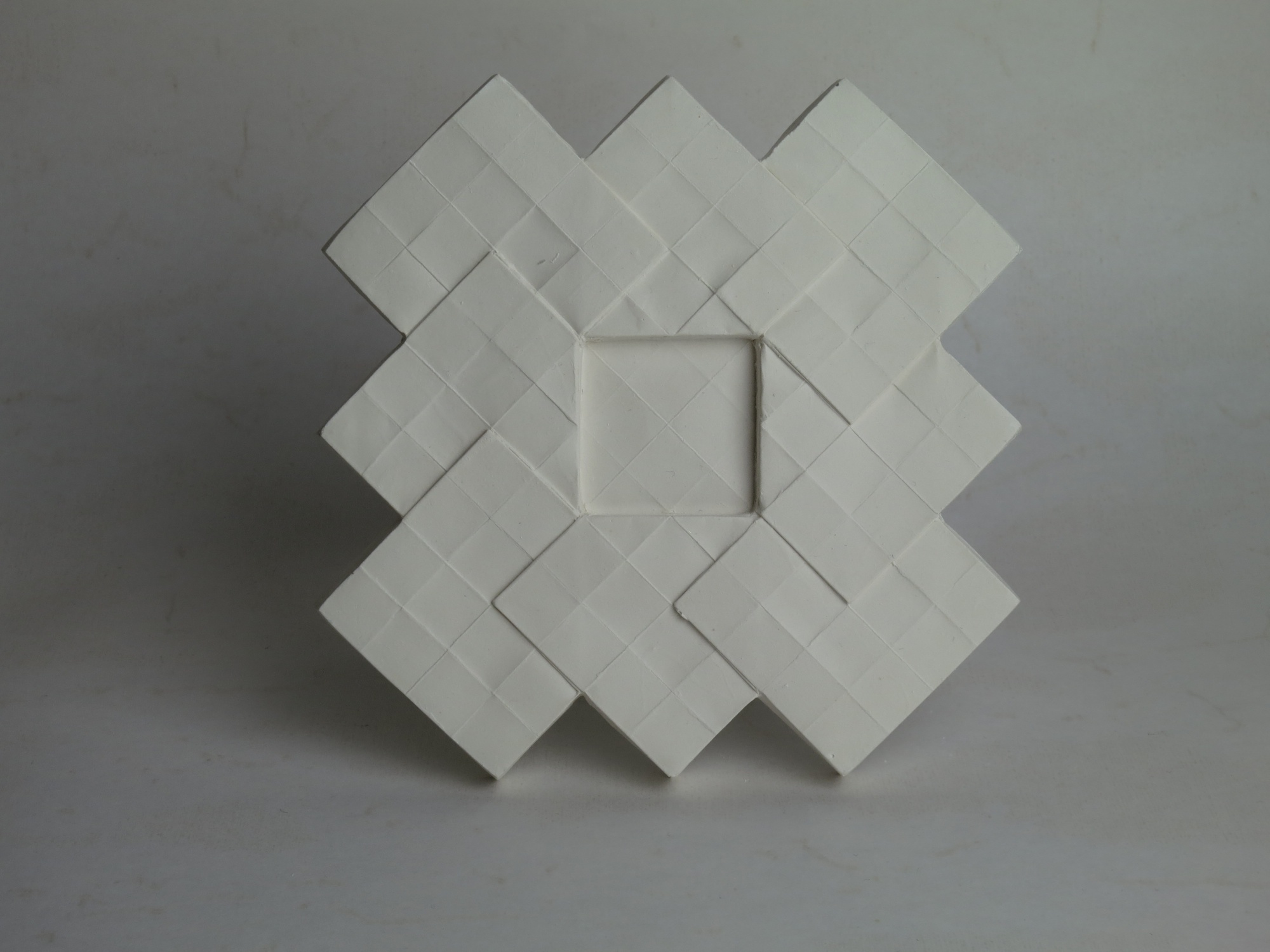 Raw plaster tile.