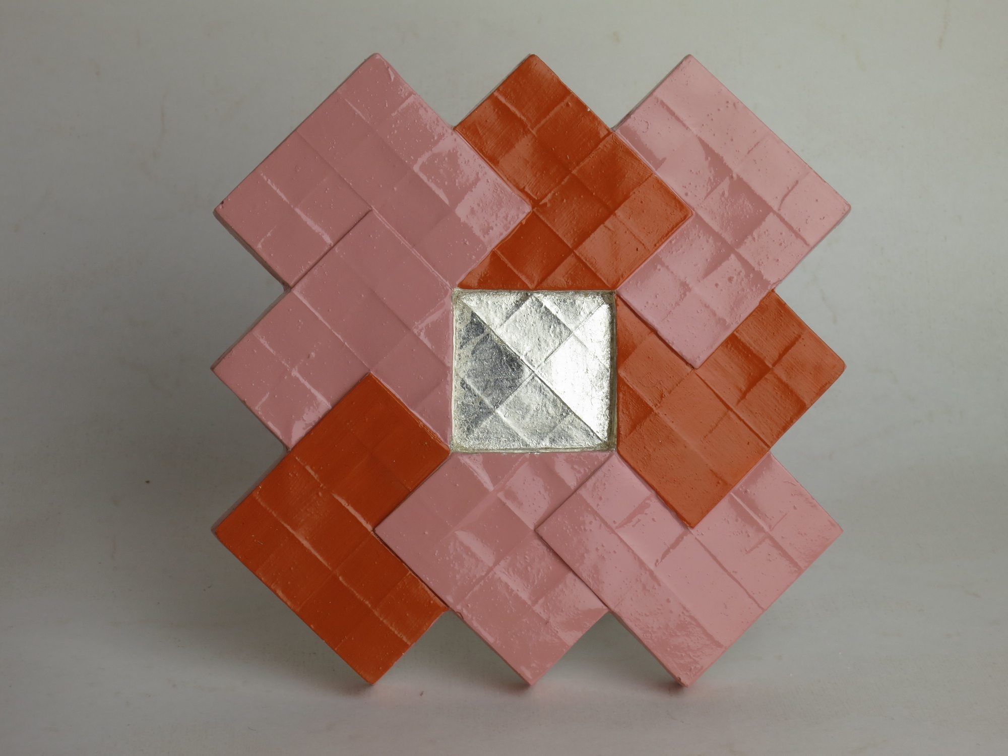 Painted plaster tile with white gold center.