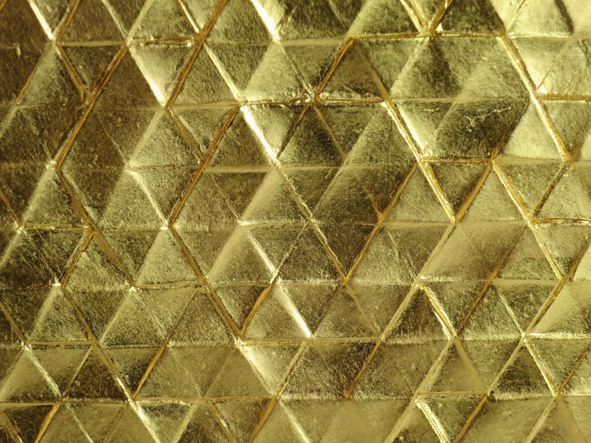Gilded plaster tile detail.