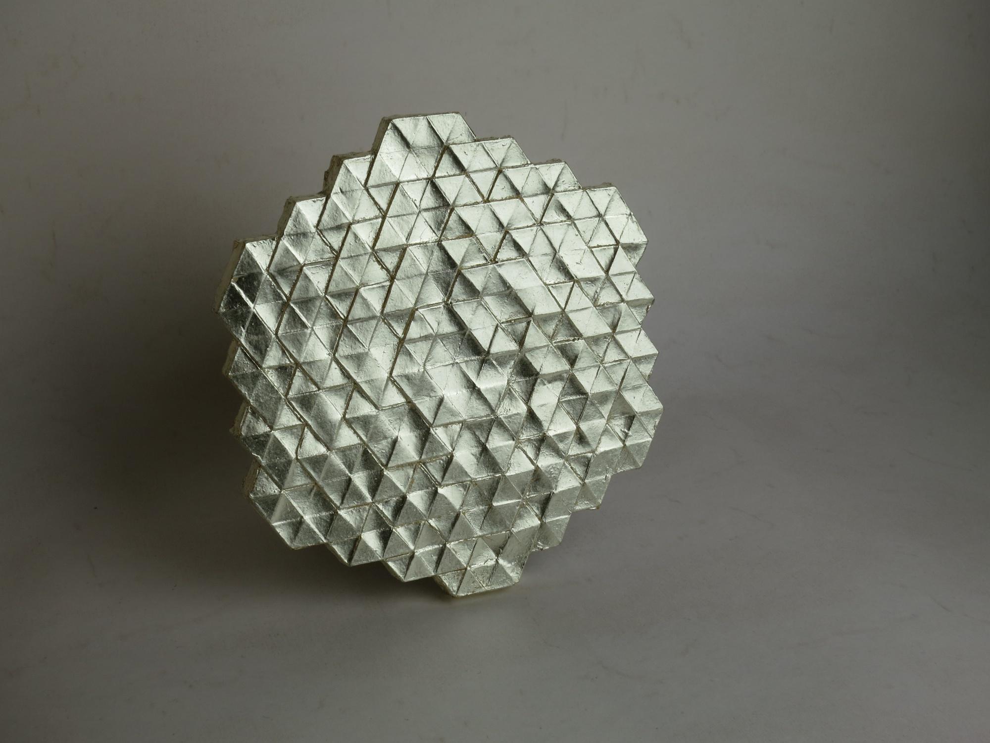 Gilded plaster tile.