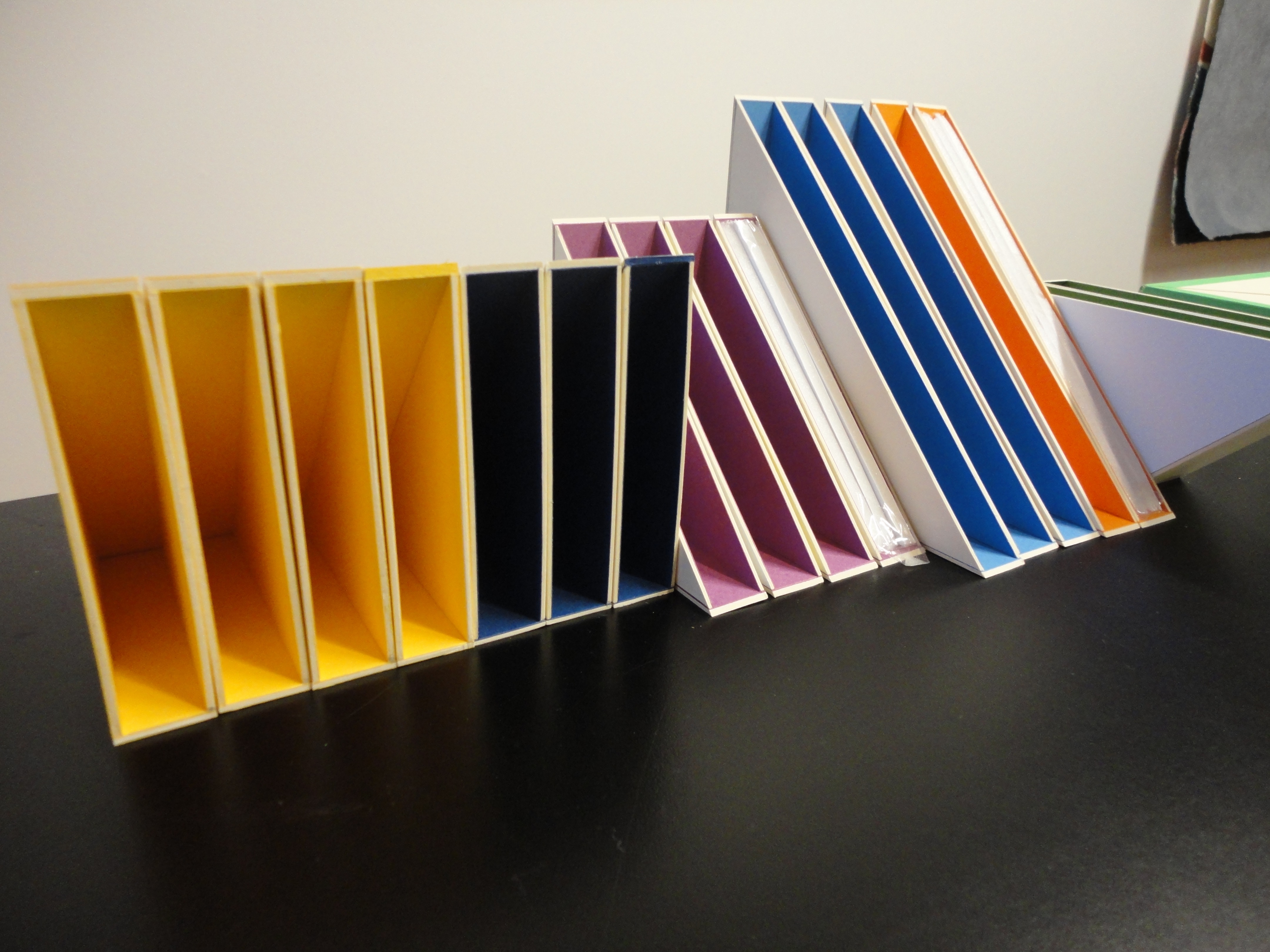 Handmade slipcases that have been lined with paper that matches the colour of the bookcloth that will cover them.