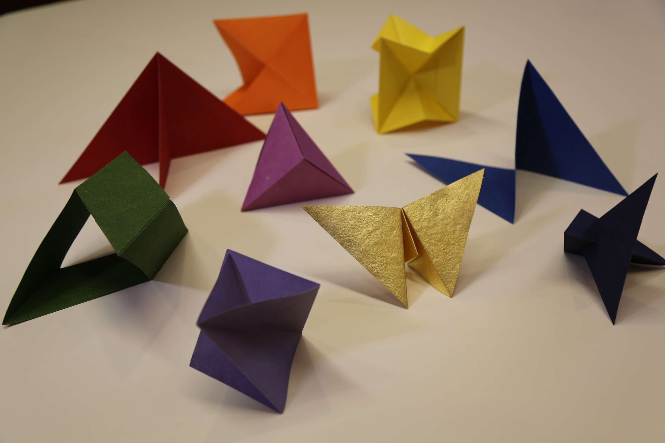 All of the nine paper structures unfolded and on display.